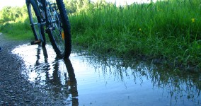 Bike in puddle by side of the road